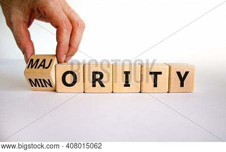 Minority Or Majority Symbol. Businessman Turns A Cube And Changes The Word 'minority' To 'majority'.