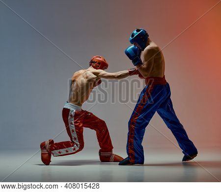 Sparring Of Fighting Males Boxers Punching During Battle In Studio, Martial Arts, Mixed Fight Concep