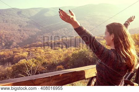 Abundance in fprest, Woman with Open Arms smiling, Connected with Nature, Enjoying Life, happiness concept