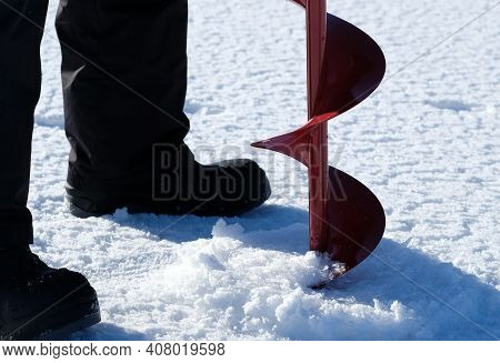 Ice Hole And Rod For Ice Fishing And Ice Drill