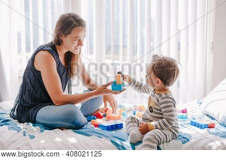 Mother And Baby Toddler Playing Building With Learning Toy Stacking Blocks At Home. Early Age Educat