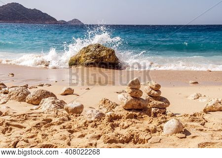 Summer Landscape, Waves With Brakes Break On A Stone, A Cairn Of Stones In The Sand, Kaputas Beach,