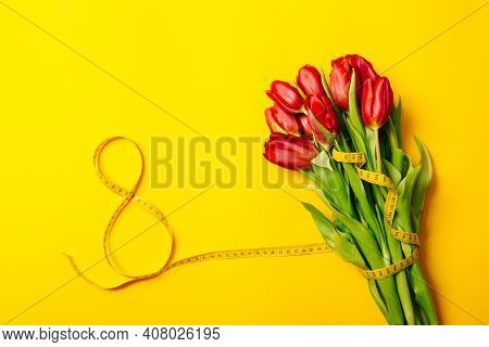 Banner With Lush Bouquet Of Red Tulips And Number Eight On A Yellow Background With Copy Space, Empt