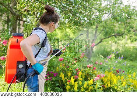Spring Summer Work In Garden, Backyard, Woman With Backpack Garden Spray Gun Under Pressure Handling