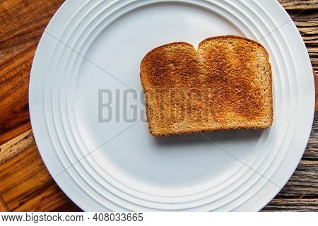 Golden toast on white plate from above