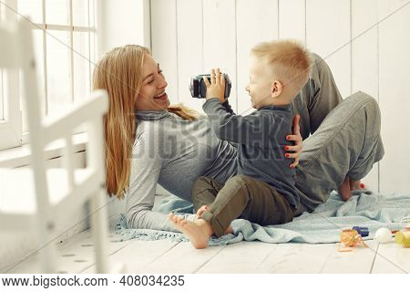 Mother And Little Son Playing At Home