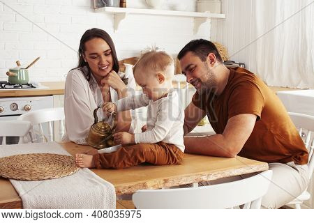 Young Family With Little Cute Son On Kitchen In Morning Happy Smiling, Lifestyle People Concept