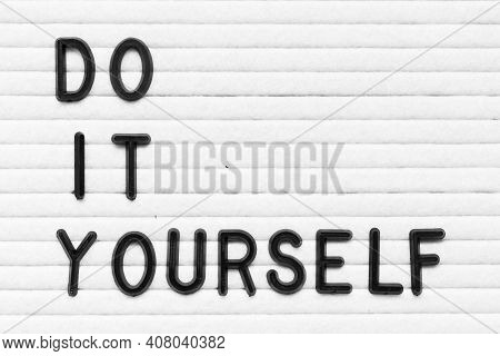 Black Color Letter In Word Do It Yourself On White Felt Board Background