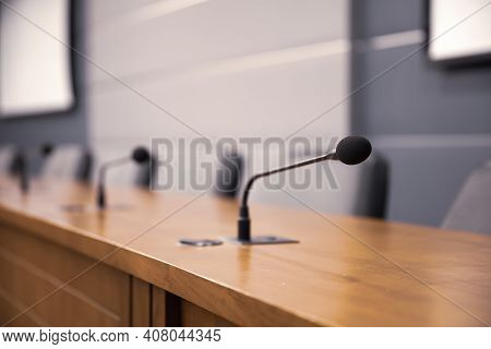 Close Up The Conference Microphone On The Meeting Table Or Board Room For Speaker And Workshop Prese
