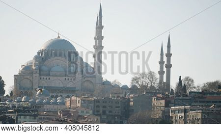 Beautiful Mosque Towers Over City. Action. Great Mosque With Its Minarets And Blue Domes Stands At T