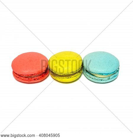 Red Yellow Blue Macaroons Isolated In White Background. Colorful French Macarons Close-up. Tasty Swe