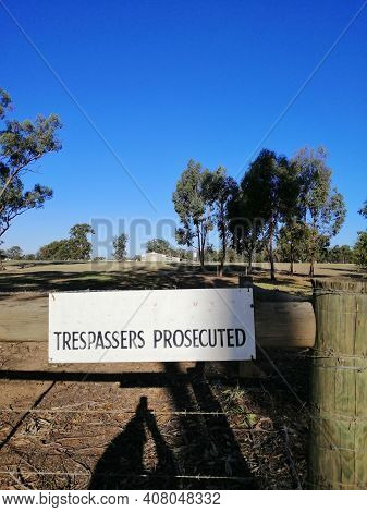 Trespassers Prosecuted Sign On The Gate Of Australian Chicken Farm.