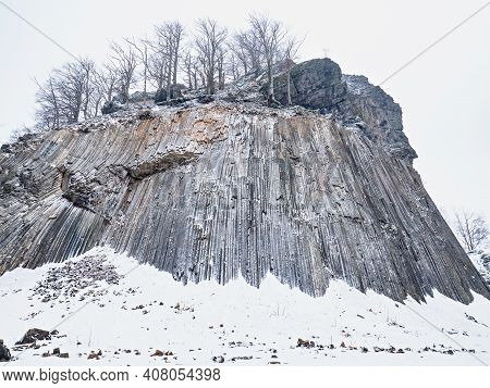 Zlaty Vrch, Rock Formation Of Pentagonal And Hexagonal Basalt Columns. Covered By Snow And Ice In Wi