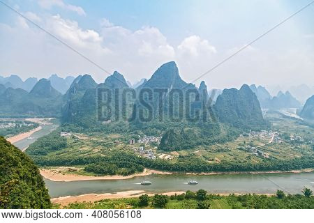 Picturesque Mountain Valleys Of Yangshuo, Guilin, Navigable River Among The Mountains, Tourist Route