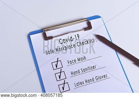 Covid-19 Safe Workplace Checklist Attached On Blue Clip Board And Pen. Workplace Safety Concept