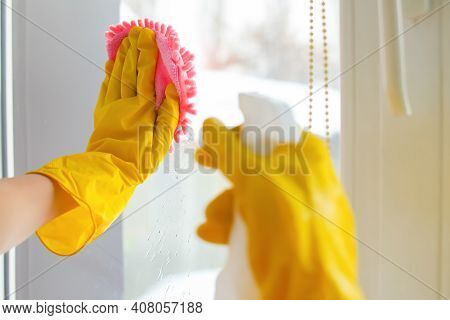 Housekeeper Maid Wearing Rubber Gloves With Cloth Cleaning Or Applying Floor Care And Cleaners At Ho