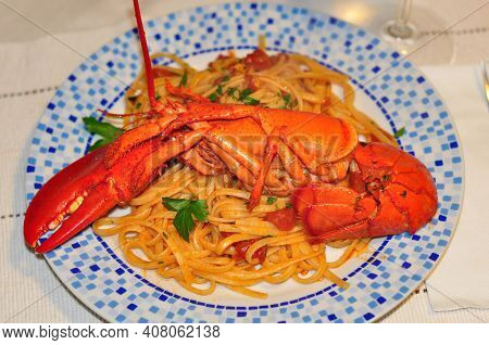 Lobster Crayfish Pasta Eat Lunch In Restaurant. Seafood Dish Lobster Spaghetti Pasta On Dinner. Cook