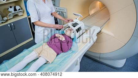 Radiologist Prepares The Little Girl For An Mri Brain Examination