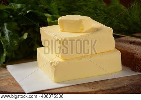 Butter. Slices Of Butter With Parsley And Bread
