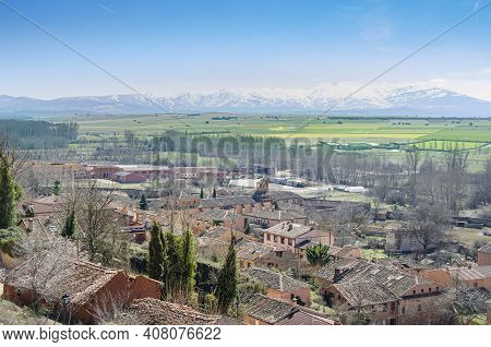 Ayllon Village View From The Top Of A Hill And In The Background, After The Sowing Fields, The Mount