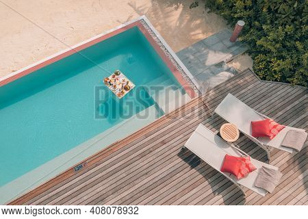 Breakfast In Swimming Pool, Floating Breakfast In Luxurious Tropical Resort. Table Relaxing On Calm