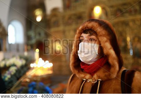 Woman In Medical Mask In Church