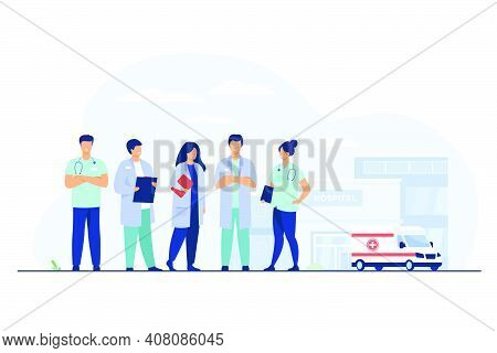 Group Of Doctors Standing At Hospital Building. Team Of Practitioners And Ambulance Car In Backgroun