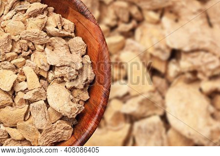 Ginger Background. Ginger Pieces In Wooden Bowl. Indian Spice Texture. Empty Copy Space Cooking Back
