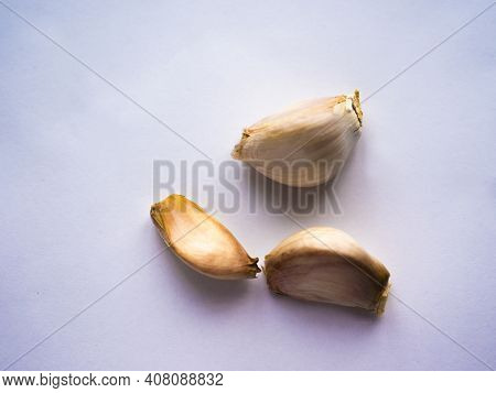 Garlic White Background. Garlic Cloves On White. Garlic Clove Isolated. Peeled, Unpeeled Garlic Clov