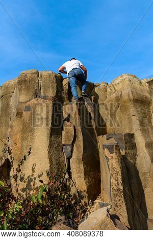 Tourists Climb Up The Basalt Pillars, Tourist Places Of Ukraine, Natural Stone Of The Basalt Rock.ne
