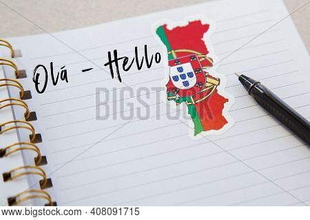 Notepad With The Words Hello In Portuguese Language, Portuguese Flag And Country Map, Pen, Foreign L