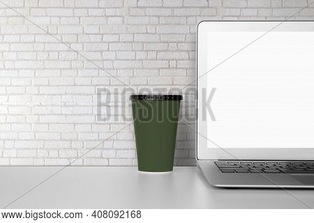 Mockup Template Laptop Computer Display Screen And Cup With Blank On Desk, Workplace And Office, Int