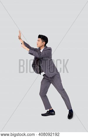 Young Asian Business Man Pushing Something Isolated On White Background, Businessman Strong And With
