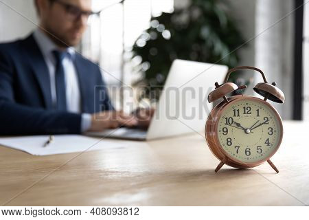 Close Up Of Male Employee Work On Computer Meeting Deadline