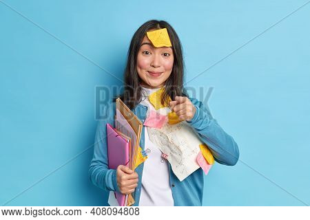 Pleased Asian Woman Office Worker With Pleased Expression Holds Folders Prepares Research Work Makes