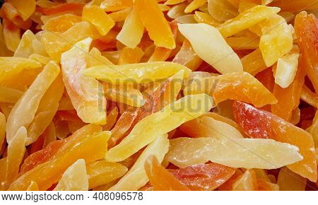 Dry Mango Fruit Heap Texture Background Pattern. Dried Mango Slice Candy Fruit Dehydrated Pattern Ba