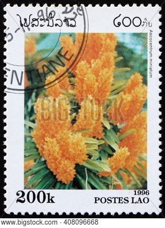 Laos - Circa 1996: A Stamp Printed In Laos Shows The Rust-red Ascocentrum, Ascocentrum Miniatum, Is