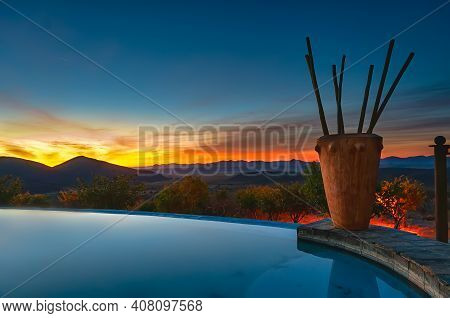 Opuwo, Namibia - August 13, 2011: View Of The Infinity Pool In A Luxury Lodge At Sunset. An Infinity