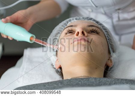 Violet Ray Treatment On Face At The Beautician.
