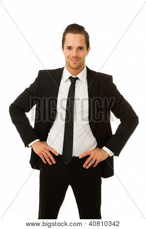 Business Man Smiling With Hands On Hips