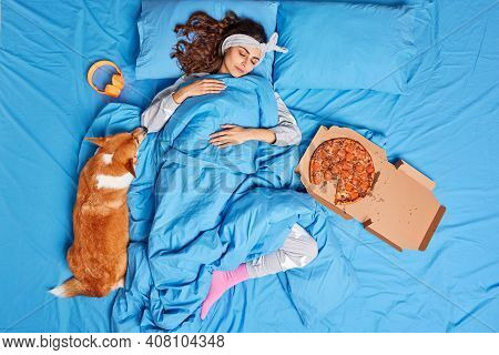 Calm European Woman Sleeps Peacefully In Bed Rests After Hard Working Day Covered With Soft Blanket