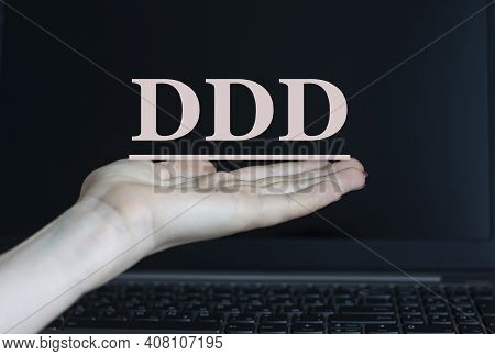 Ddd (domain Driven Design) - Acronym On A Woman's Hand Against The Background Of A Laptop. Internet