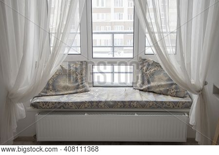 A Window In The Bedroom With Curtains, A Cozy Apartment, A Place To Relax.
