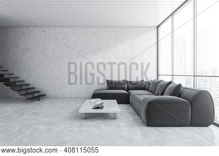 White And Black Waiting Room With Black Sofa For Clients In Business Office. Light Office Room With