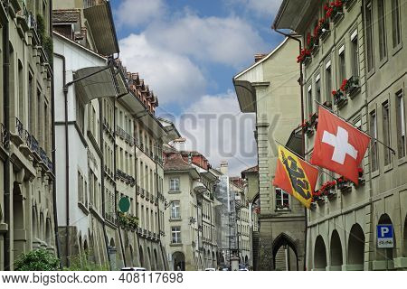 Street Scene In Central Bern Switzerland With The Swiss And Bern Flags Flying