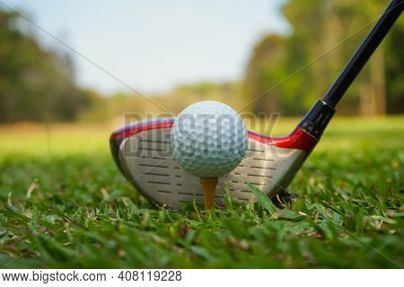 Golf Club And Ball On Green Grass Ready To Be Struck On Golf Course Background, Lens Flare On Sun Se