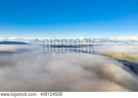 Above The Clouds At Portnoo In County Donegal With Fog - Ireland