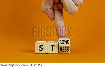 Strong Stress Symbol. Businessman Turns Wooden Cubes With Words 'strong Stress'. Beautiful Orange Ba