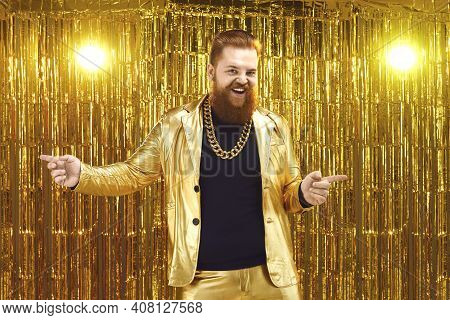 Uninhibited Bearded Man In Shiny Golden Suit Dancing And Having Fun At Disco Party