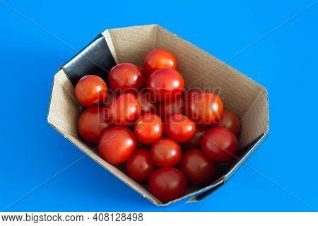 Ripe Cherry Tomatoes In The Cardboard Box